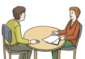 Bild von zwei Personen am Tisch, die ein Gespräch führen